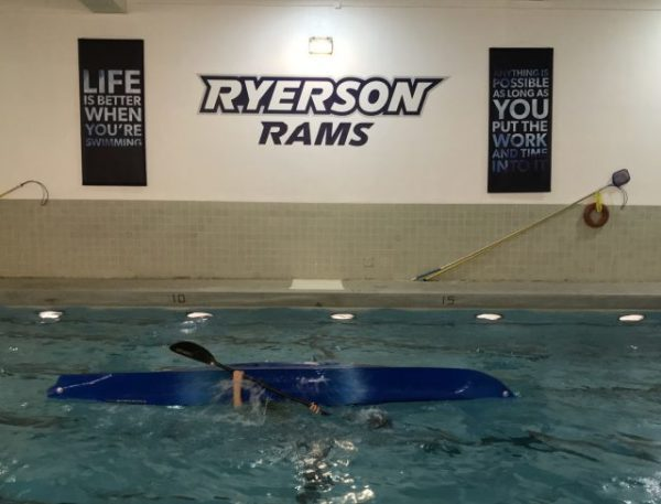 Kayak rolling course in the pool at Ryerson.